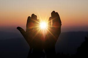 Faith of christian concept: Spiritual prayer hands over sun shin